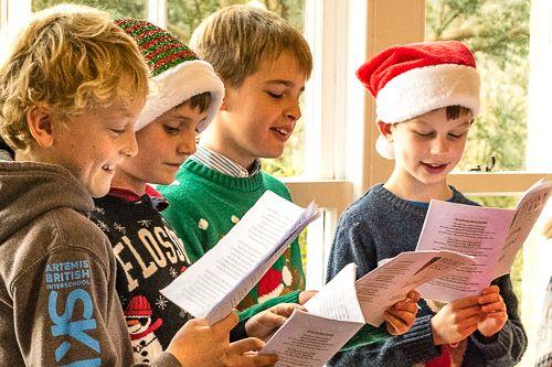 boys singing carols