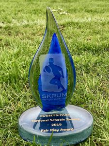 Blue glass trophy on grass